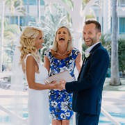 Gethin and Lianne laughing during their wedding ceremony