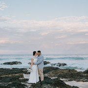 Beautiful photo of Kane and Ashley on sunset on the Currumbin rocks after their wedding
