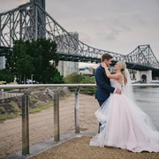 Tess and Peter celebrate their Love after their wedding with Brisbane's Storey Bridge in the background.