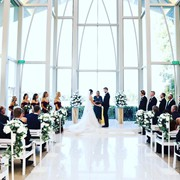 Teegan and Nick get married at the Glass Chapel at Sanctuary Cove