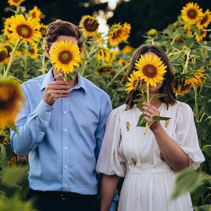 Newlyweds Ben and Jessica wearing their Sunflowers after their marriage