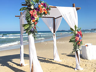 Colourful beach wedding arbour styled by styled by Angelina Arnold of Breeze Weddings Gold Coast