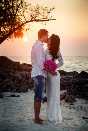 Wedding couple kiss at sunset